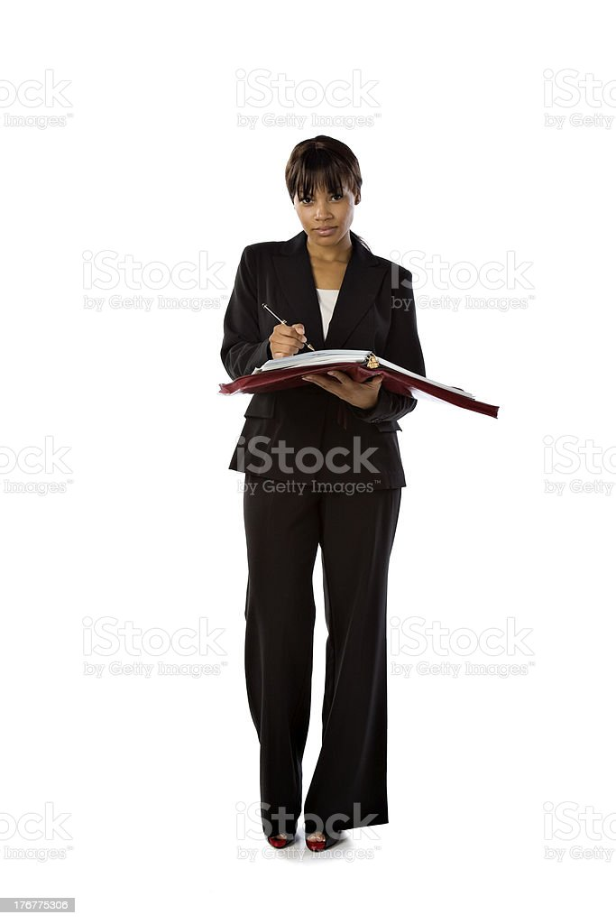 Professional Black Businesswoman Writing in Her Notebook royalty-free stock photo