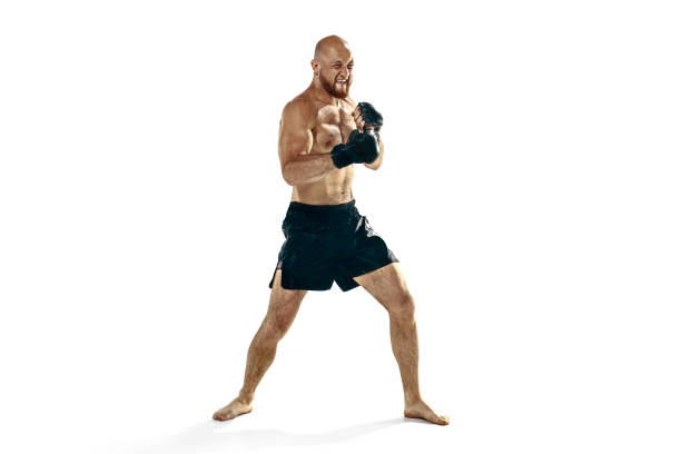 professional boxer boxing isolated on white studio background - combat sport stock pictures, royalty-free photos & images