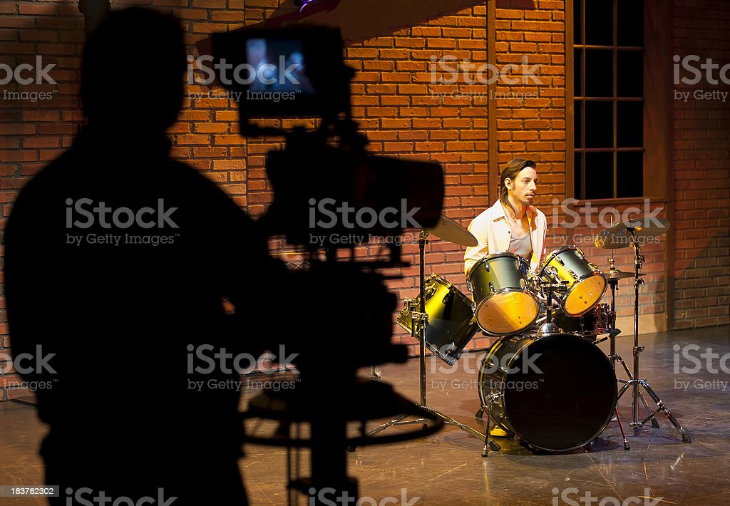 Professional broadcast video camera in studio shooting a scene royalty-free stock photo