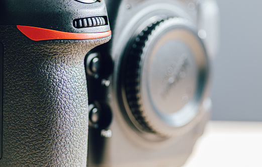 Professional build quality modern DSLR and front buttons close up, built with rugged magnesium alloy and carbon fiber materials, a sturdy camera with flagship technology,