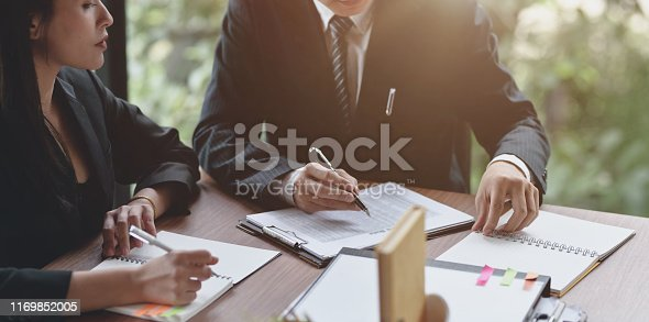 1068752548istockphoto Professional business people discussing the projec 1169852005