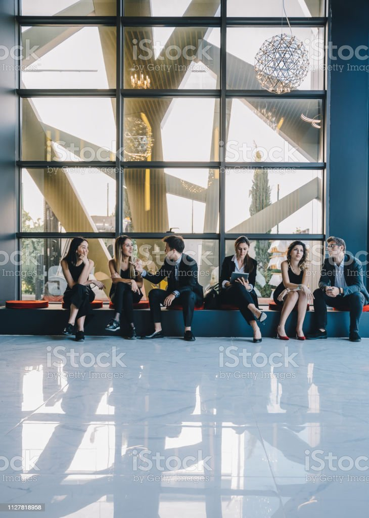 Shot of a row of multi-ethnic business people group waiting in line...