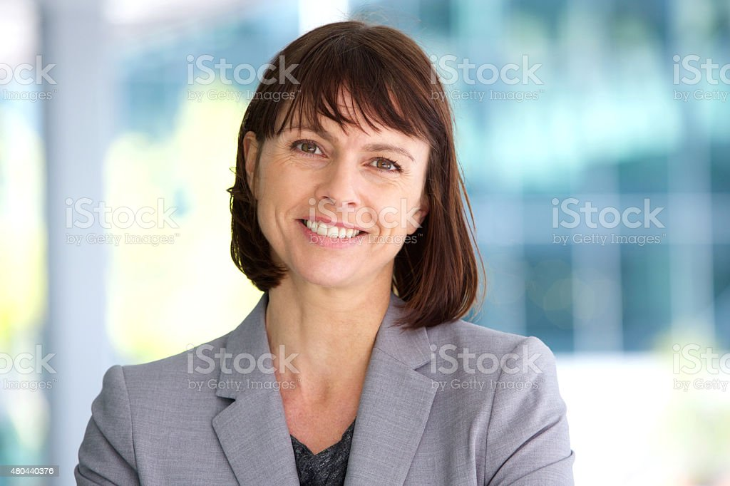 Professional business woman smiling outdoor stock photo
