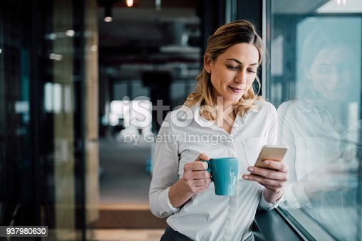 Beautiful business woman Texting in the coffee break