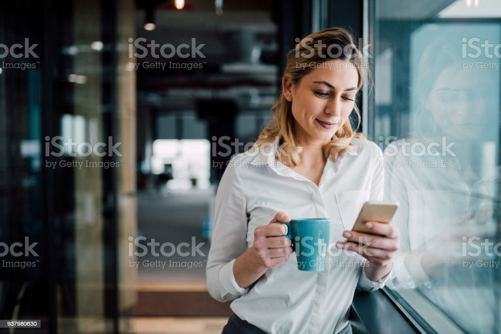 Professional Businesswoman texting stock photo