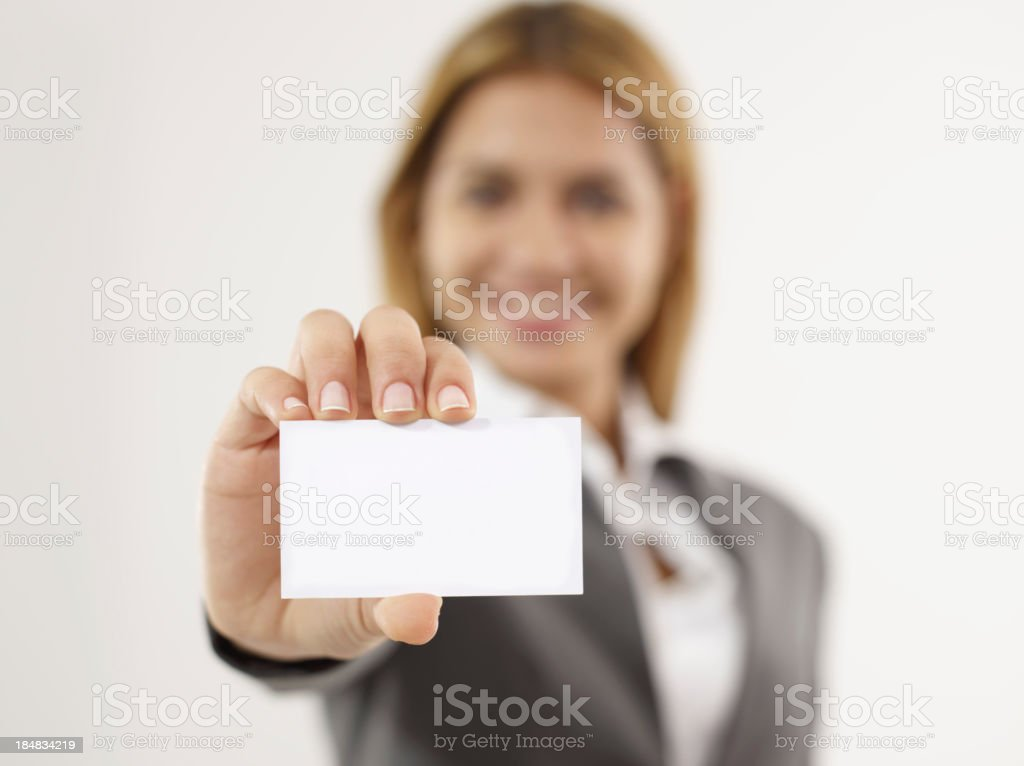 Professional businesswomen wearing suit holding blank card royalty-free stock photo