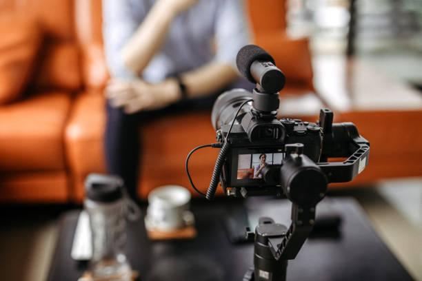 professional camera filming a video podcast - videocamera foto e immagini stock