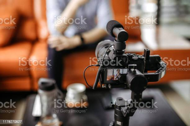 Professional Camera Filming A Video Podcast Stock Photo - Download Image Now