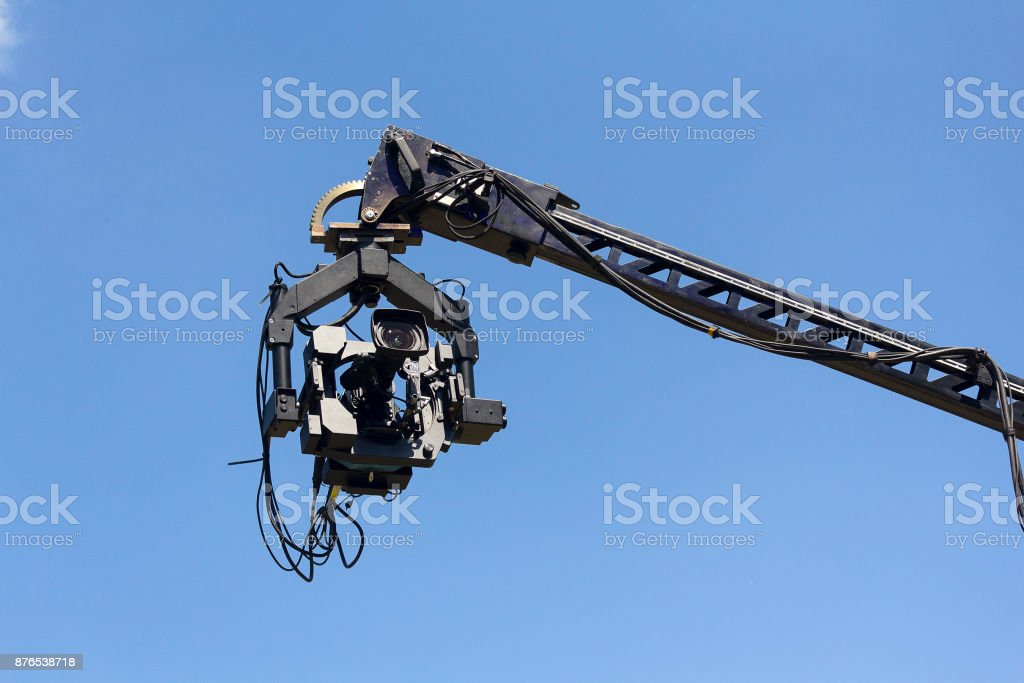 Professional camera on the crane against the sky stock photo