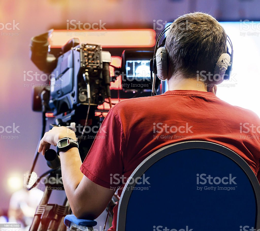 A professional cameraman working royalty-free stock photo