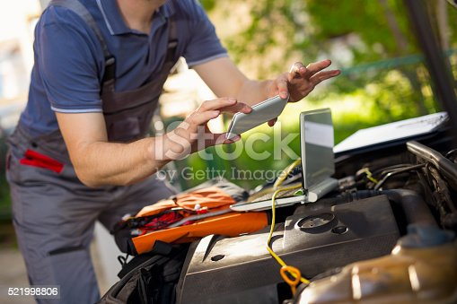 istock Professional car mechanic using smartphone to take pictures 521998806