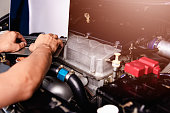 istock Professional car repair or maintenance mechanic engine working service with laptop computer 1189648042
