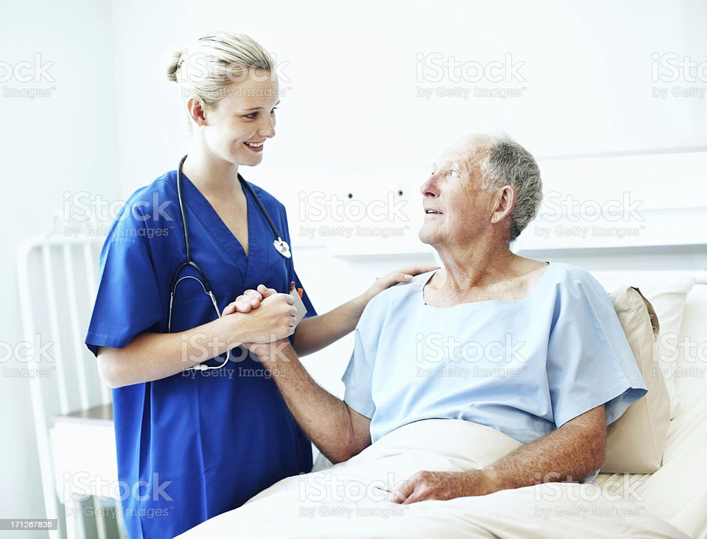 Professional care and a friendly smile make all the difference royalty-free stock photo