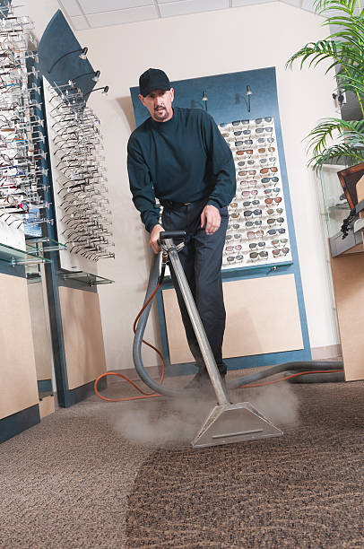 A professional carpet cleaner at work stock photo
