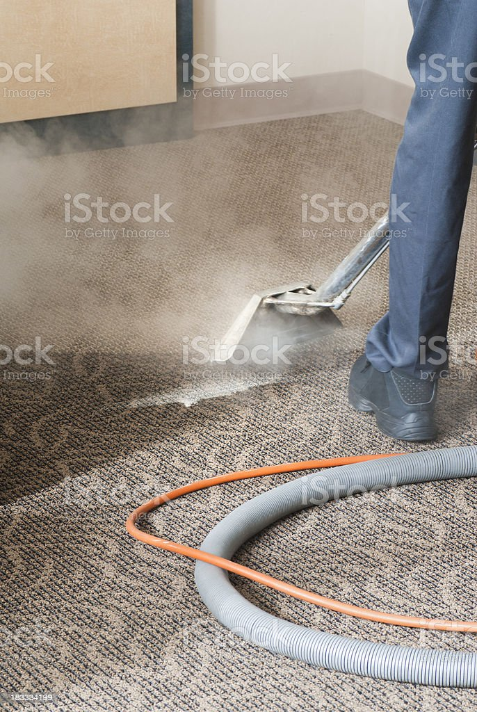 Professional Carpet Cleaner - Steam Cleaning stock photo