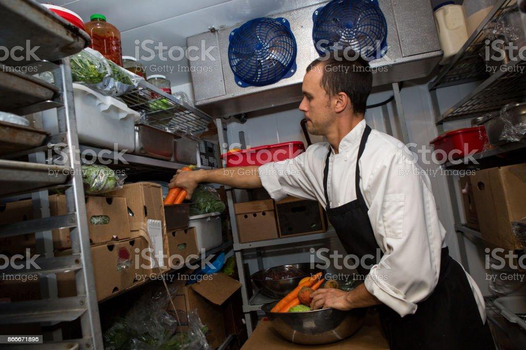 Professional chef in his fridge stock photo
