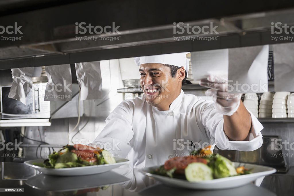 Professional chef in kitchen stock photo