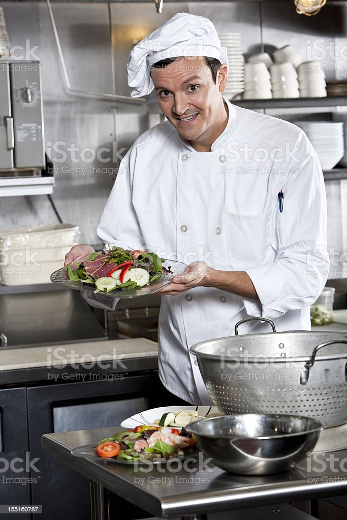 Professional chef with gourmet appetizer stock photo