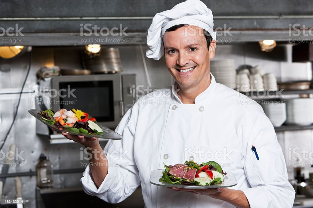 Professional chef with gourmet appetizers stock photo