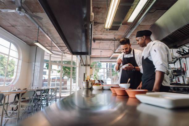 Professional chefs working at restaurant kitchen stock photo