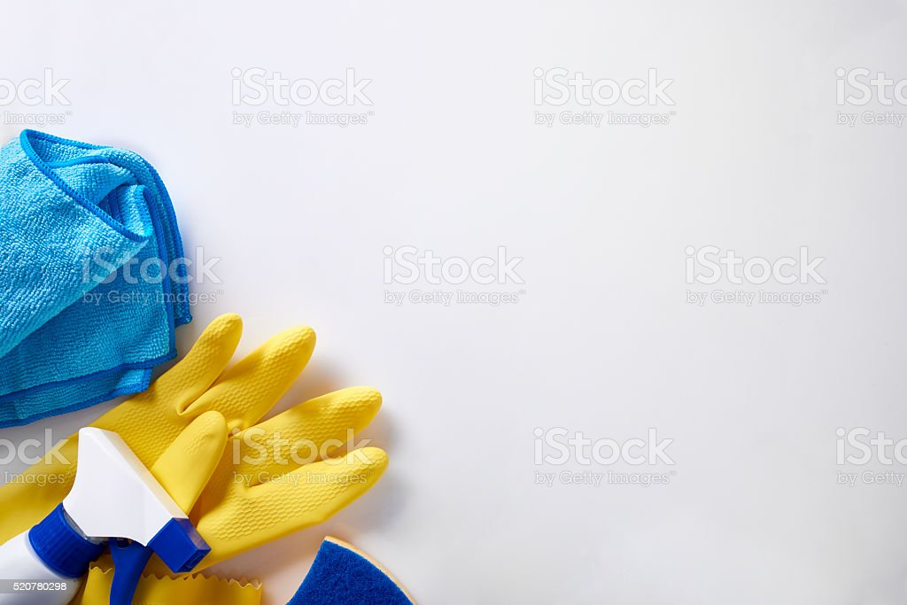 Professional cleaning equipment on white table top view isolated stock photo