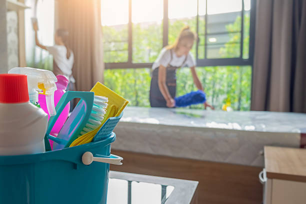 professional cleaning service team working with cleaning equipment in room. cleaning service concept. - clean stock pictures, royalty-free photos & images