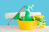 istock Professional cleaning set for window, mirror or other glass surfaces washing. Blue background. Cleaning service concept. Early spring regular clean up. Front view. 940073750