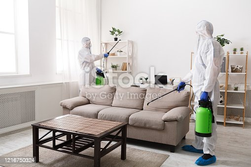Professional cleaning with disinfectant spray of all home, flat surfaces, quarantine, coronavirus epidemic