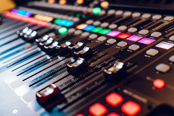professional concert mixing console is equipped with high-precision and long-stroke faders - radio dj stock photos and pictures
