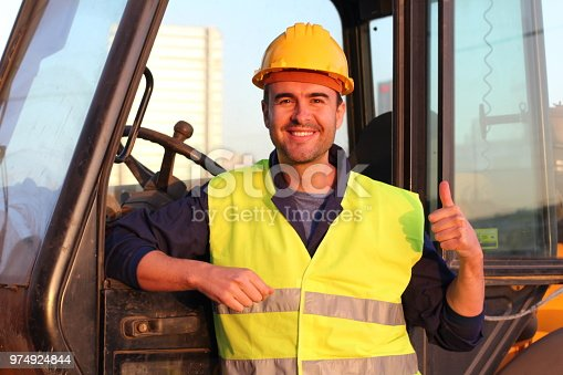 istock Professional construction industry driver giving thumbs up 974924844