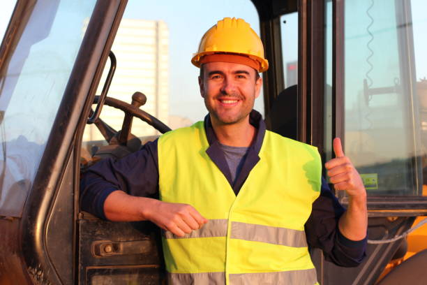 Professional construction industry driver giving thumbs up Professional construction industry driver giving thumbs up. agricultural machinery stock pictures, royalty-free photos & images