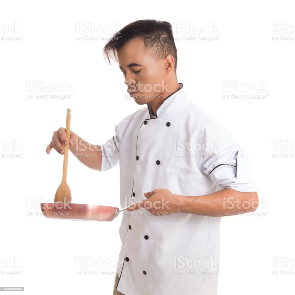 professional cook is preparing a dish young black man is in white