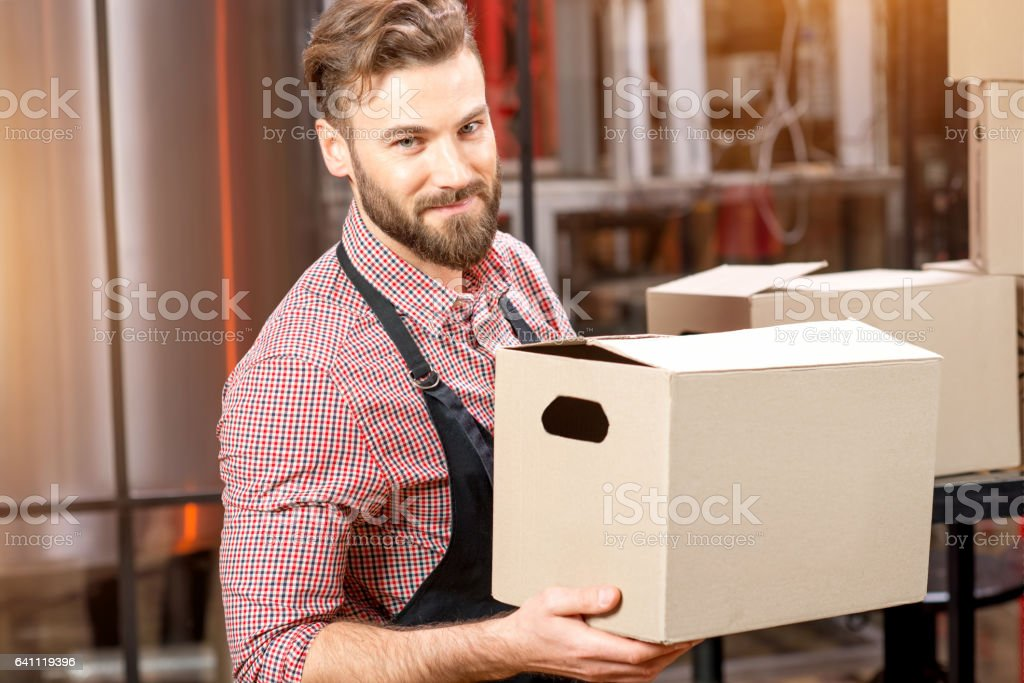 Professional courier with boxes stock photo
