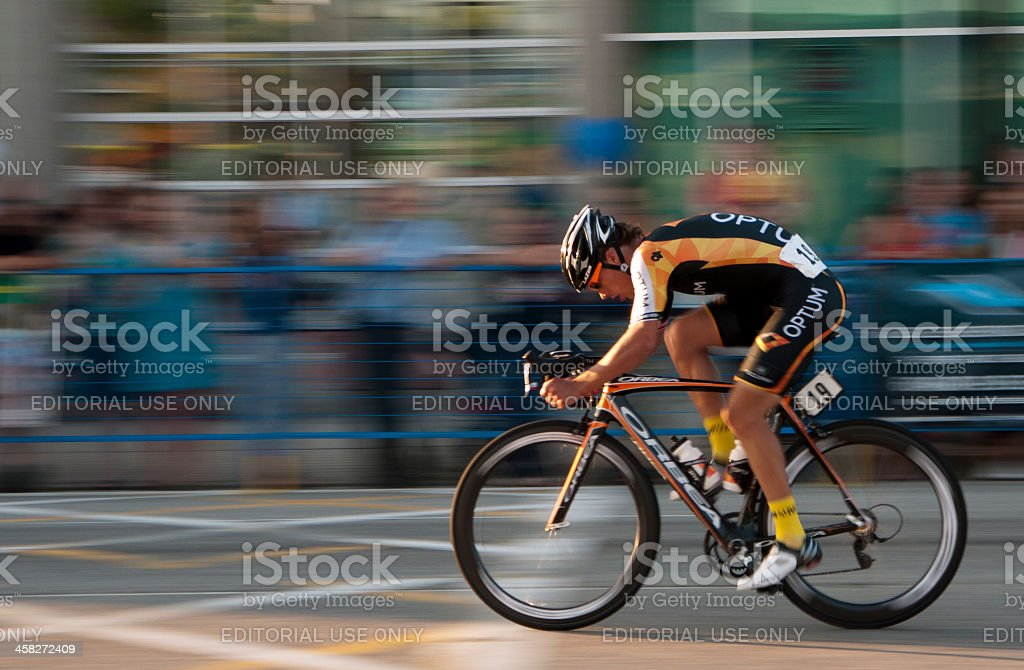 Professional Cyclist and a blur of spectators stock photo