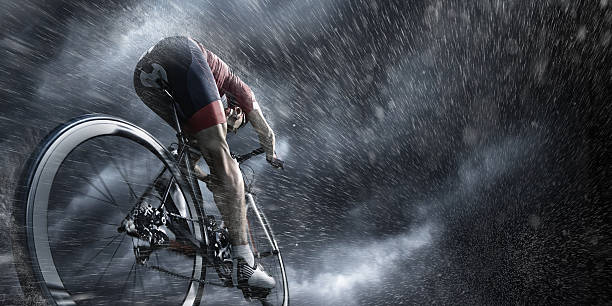 professional cyclist under stormy sky - endurance stock pictures, royalty-free photos & images