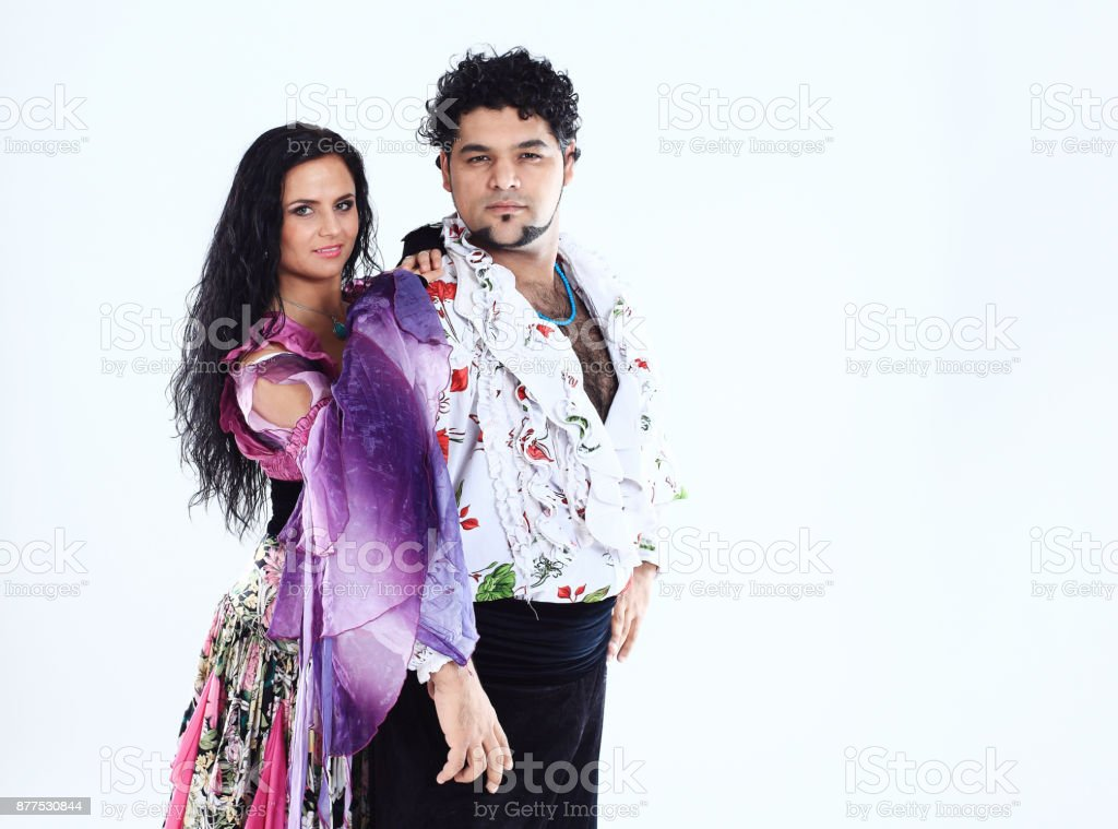 professional dance couple in a Gypsy costume perform folk dance stock photo
