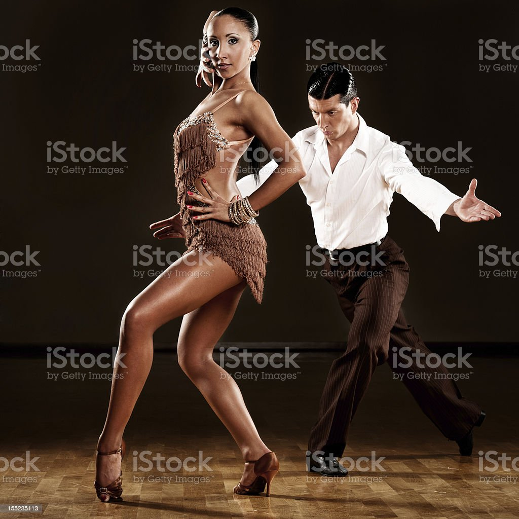 Professional dancing couple performing in ballroom stock photo