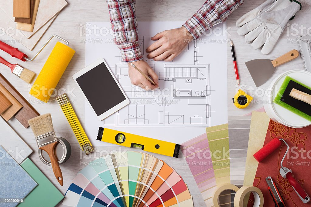 Professional decorator working at desk stock photo