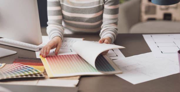 Professional designer searching color swatches stock photo