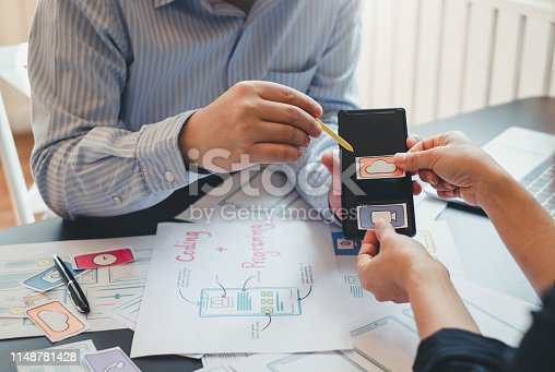 istock Professional designer website application app development ui ux on mobile phone. 1148781428
