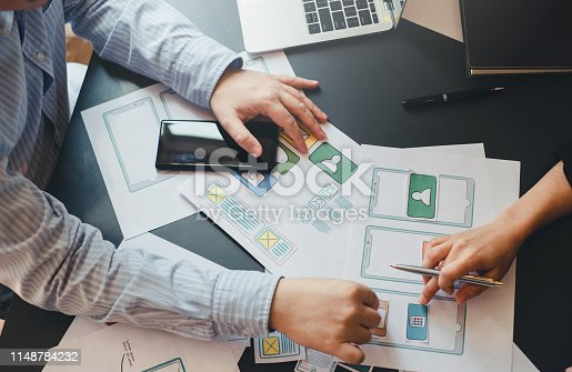 istock Professional designer website application app development ui ux on mobile phone. 1148784232