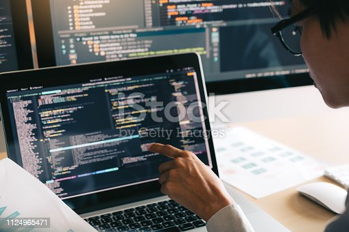 istock Professional development programmer cooperating meeting programming website working a software in office room. 1124965471