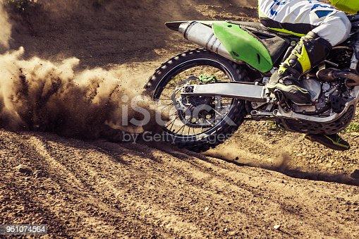 Close-up of motocross wheel. Professional dirt bike rider