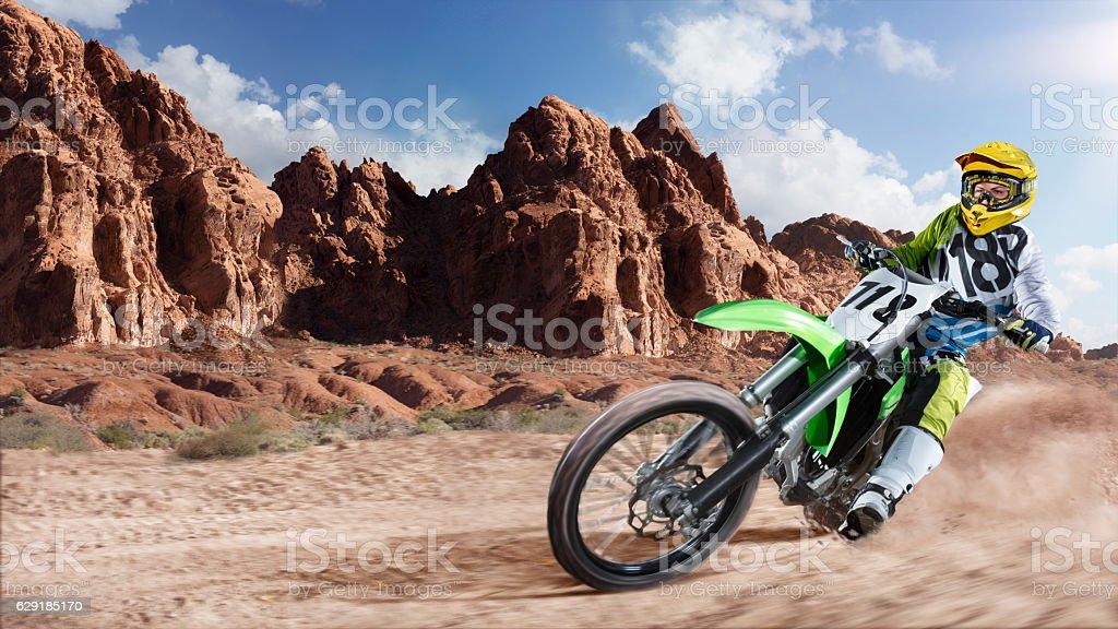 Professional dirt bike rider racing on the desert stock photo