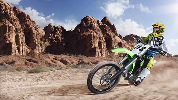 Professional dirt bike rider racing on the desert – Foto