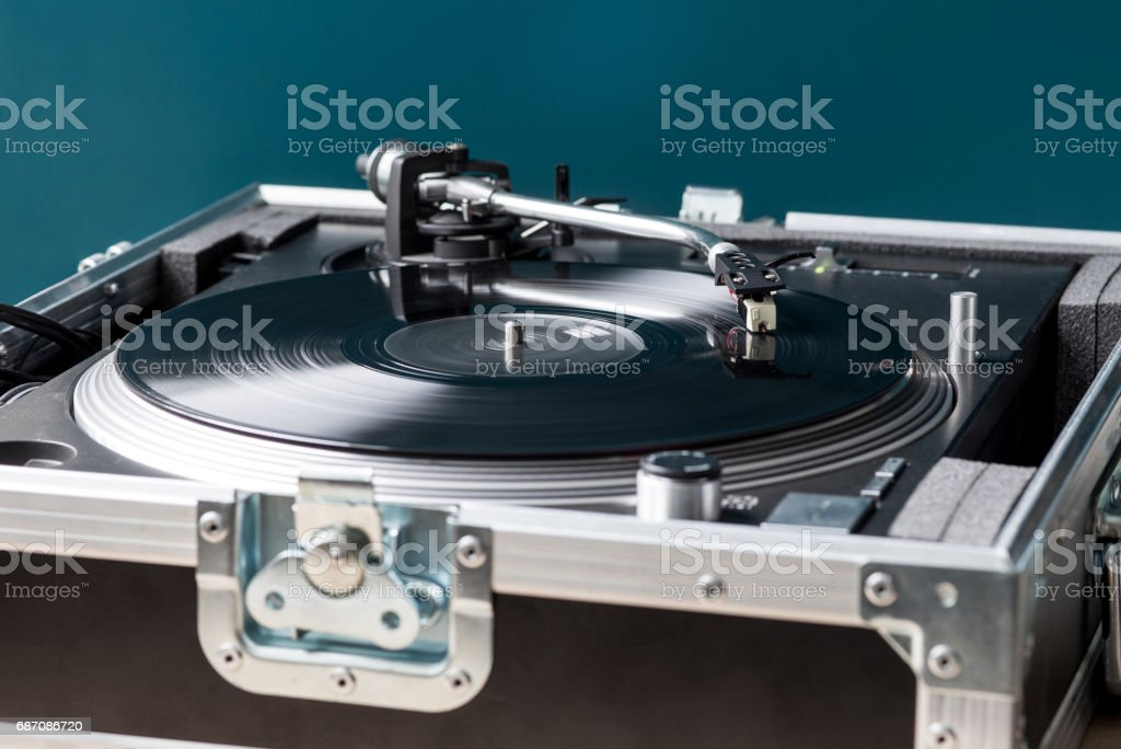 Professional DJ Turntable in Flightcase Playing Record stock photo