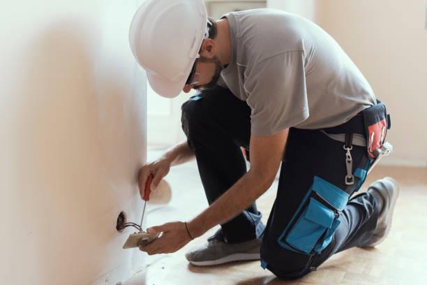 professional electrician, installing sockets at home - cavo componente elettrico foto e immagini stock