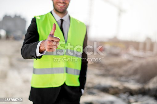 1041465228 istock photo Professional engineer architect worker with protective helmet and blueprints paper construction site 1183768749