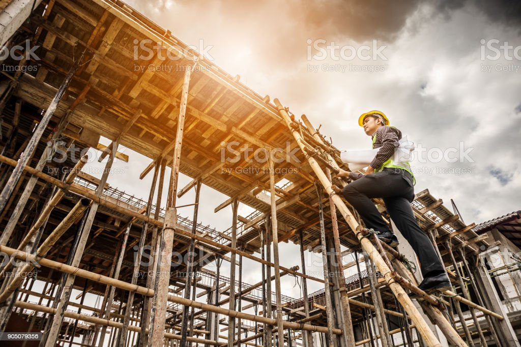 professional engineer worker at the house building construction site stock photo