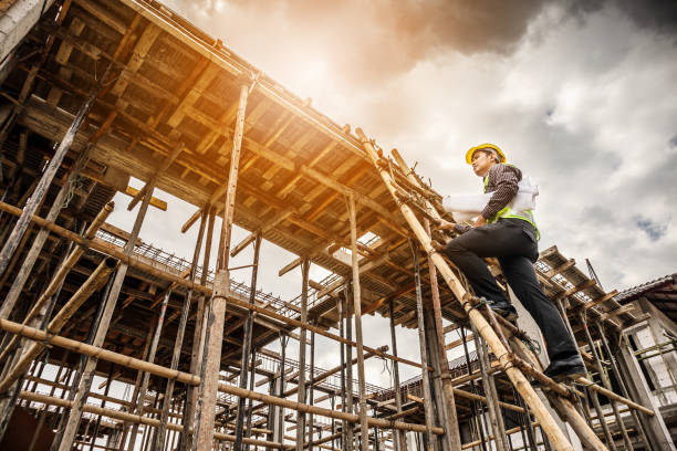 professional engineer worker at the house building construction site - builders stock photos and pictures